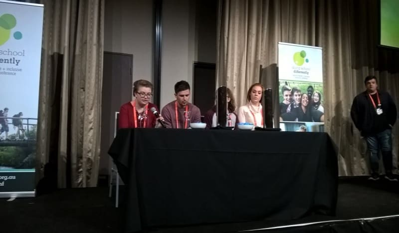Maddie on the panel answering questions from the audience.